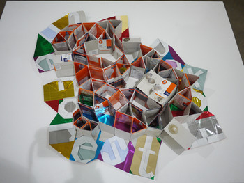 Haegue Yang, Light House (Osram): Bewitched in Time, 2010, cardboard light bulb packaging, corraline, origami paper, 70 x 48 x 7 cm