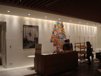 Installation view at G-tokyo x New Tokyo Contemporaries Salon 2011, Arataniurano (Tokyo) showcases Tatzu Nishi's work (left) and ZENSHI (Tokyo) showcases Masayoshi Hanawa's work (right)