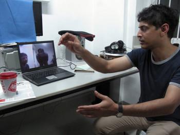 Kiran Subbaiah presenting his work Mirrorage, 2011