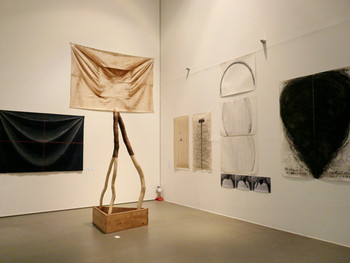 Installation view of Kunyong Lee's works, clockwise from the centre, Untitled 83-3-2005, 1983 (reproduced in 2005), wood; Cloth-C, 1974, cloth, oil paint; Cloth-Sack, 1974, sack, oil paint; Body Drawing, 1976, magic ink on paper, 2 pieces; Drawing, 1984, photograph, pencil on paper; Message and Communication, 1989, conte on paper