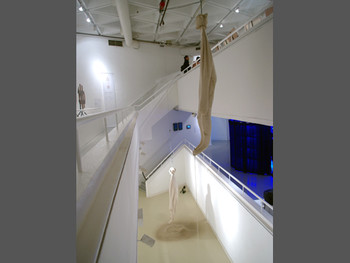 Liu Liyun and George Wong, In • Between, 2011, kinetic installation with fabric, sand, stainless-steel funnels, steel cable and pulleys at '1+1: Shenzhen, Hong Kong, Taipei, Macau Art Exchange Exhibition', Hong Kong Arts Centre