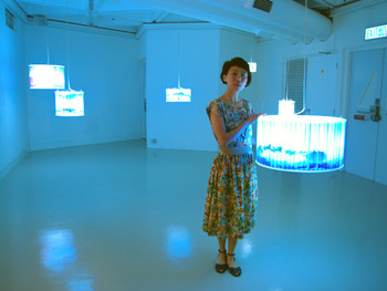 wen yau with her collaborative work with Chen Chih-Chien, Square, 2011, pinhole photography and acrylic light boxes at '1+1: Shenzhen, Hong Kong, Taipei, Macau Art Exchange Exhibition', Hong Kong Arts Centre