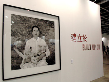 (left) Marina Abramovic, Portrait with White Lamb, 2010, black and white photographic print; (right) Lawrence Weiner, BUILT UP ON, 1988, language & the materials referred to, at ART HK 11