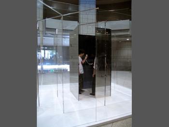 Yoko Ono, TELEPHONE IN MAZE, 2011, telephone, wood, acrylic, half mirror, aluminum, iron. Presented at the Yokohama Museum of Art