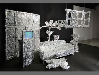 Geng Jianyi, The content is distributed by its shadow, 2011, installation, darkroom, aluminum-foil paper, sofa, TV, wardrobe, plastic plants, 350 x 670 x 1161 cm