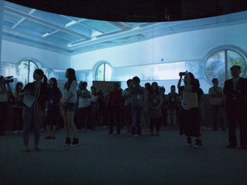 Crowds gathered in Yuan Goang-Ming's (袁廣鳴) 360° video installation Before Memory III, 2011