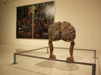 Tallur L N, Lamp (deepa sundari), 2010, bronze and concrete, 140 x 100 x 60 cm (foreground); Leslie De Chavez, Last Song Syndrome, 2010, oil on canvas, 391 x 300 cm (background)