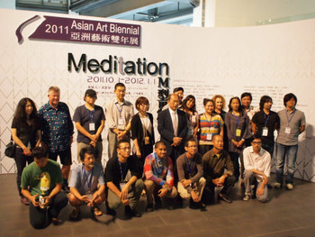 Participating artist who were present taking a group photo with exhibition curator and Museum Director