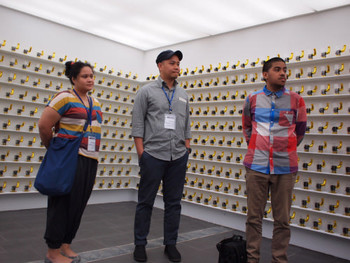 Art group Tromarama talking to the press in their installation Silent Dialetica, 2011, acrylic board, bells, thread, 1000 pieces