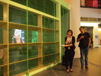Artist Xu Tan (徐坦) and curator Iris Huang Shu-Ping (黃舒屏) talking to the press in front of his Keyword School in Taichung