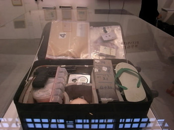 Items in a suitcase for the 'Messenger Exhibition'.