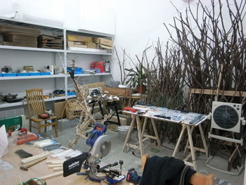 A corner of Shi Qing's studio where the artist uses found materials to construct a three-dimensional installation that will then be printed as a trompe l'oeil painting.