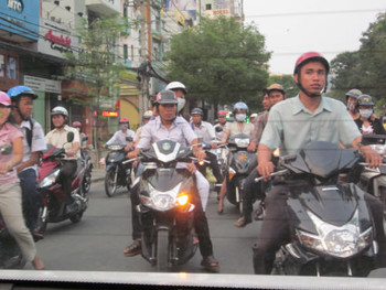 Motorbikes on a bustling road in Ho Chi Minh City