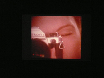 Anne Collier, Woman with a Camera 35mm, 2009, slide projection.
