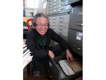 Lee Kyun-yong, beside the drawer containing his files