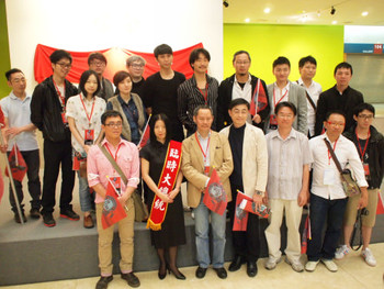 Museum director Beatrice Hsieh (sashed) with participating artists