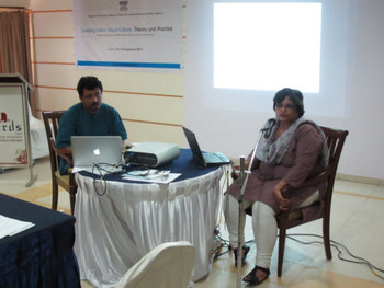 Artist and lecturer Shukla Sawant making a presentation, chaired by art historian Anshuman Dasgupta.