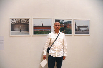 Yu Xudong (Mainland China) and his work <i>One Person's Parade</i> at Documentaries of Chinese Performance Art 2008 exhibition.