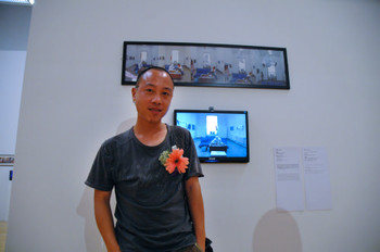Wen Peng (Mainland China) and his work <i>Bungee Jumping</i> at Documentaries of Chinese Performance Art 2008 exhibition.