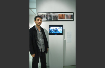 Tran Luong (Vietnam) and his work <i>WELTS!</i> at Performance Art in Asia: Exhibition by Invitation 2008.