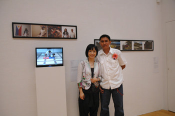 AAA Research Coordinator Janet Chan and Ronaldo Ruiz (Phillipines) with his work <i>The Assassin</i> (left) at Performance Art in Asia: Exhibition by Invitation 2008.