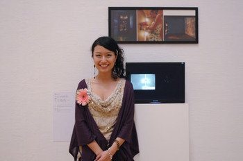 Peng Yun (Mainland China) and her work <i>Light</i> at Documentaries of Chinese Performance Art 2008 exhibition.