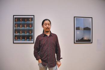 Zhou Bin (Mainland China) and his work <i>One Yuan, Chasing the Sun</i> (right) at Documentaries of Chinese Performance Art 2008 exhibition.