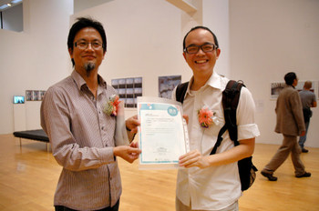 Curator Ng Fong-chao and Merit Award winner Pak Sheung-chuen Tozer (Hong Kong) at exhibition opening.