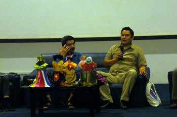 Artist Chumpon Apisuk and curator Ark Fongsmut in discussion at Land of Forum.