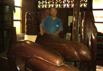 Artist Inson Wongsam with his sculptures in his studio.