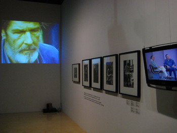 Installation view. Front: William Gedney, Cage Picking Mushrooms, 1967