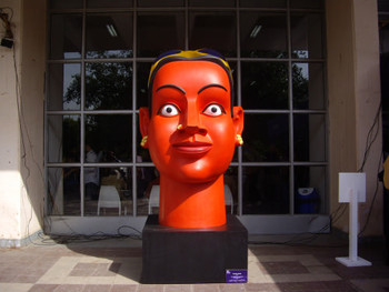 Ravinder Reddy's giant head greets viewers at the entrance