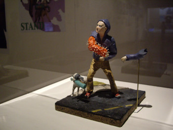 Gregory Sholette, WTO Action Collectible (With Spring =Action Arm), 2002