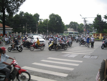 Crossing a busy intersection in Ho Chi Minh on the way to the HCMC Fine Art University