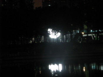 Reflected view of Wang Yuyang's The Artificial Moon in Xuhui Park.