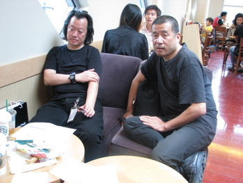 Yao Dajuin (left), curator of Streaming Objects, and Zhang Peili (right),