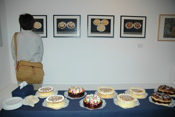 Image: Work by Phoebe Man, including home-made cakes served at the opening.
