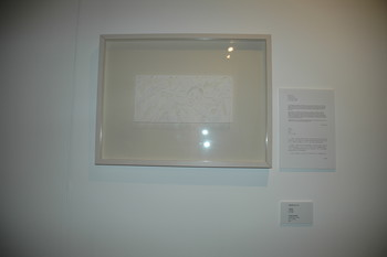 Image: Display of Bovey Lee, <i>Trading Identity</i>, framed paper cutting, 2006. Documentation of <i>Talkover/Handover</i> by Phoebe Wong, 2007.