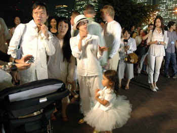 Audience members dressed in white waiting to join Terence Koh's performance at Unga Park.