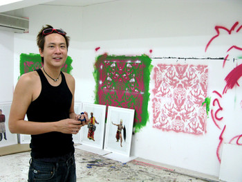 Young artist, Vincent Leong, in his studio