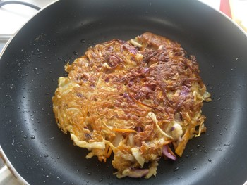 Image: With the recent pandemic, cooking at home has become more common, which shows that we're all capable of taking care of our own meals. This image shows a vegan okonomiyaki.