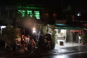 Image: A hangout after Bruno Isaković's performance <i>Denuded</i> on 19 November 2014, in front of Green Papaya Art Projects in Quezon City. Courtesy of Green Papaya Art Projects.