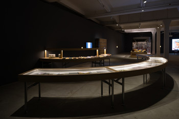 Image: <i>An Archivist's Table</i>, installation view of <i>Portals, Stories, and Other Journeys</i>, Tai Kwun Contemporary, 2021. Photo: Kwan Sheung Chi.