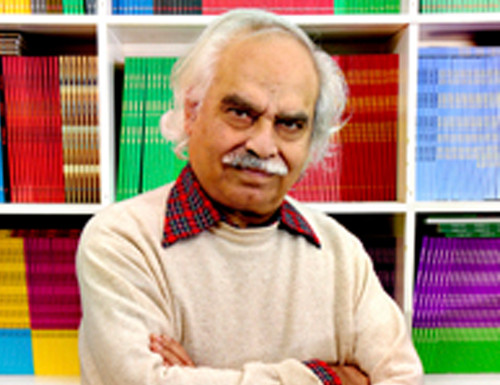 Rasheed Araeen in front of Third Text archive,