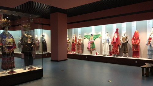 Image: The exhibition hall of bridal dresses. Over one hundred from fifty-six ethnic groups were showcased, reflecting their various hopes and dreams. Courtesy of the Women's Culture Museum and Li Xiaojiang.