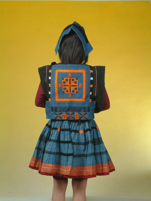 Image: Garments of the Baikuyao ethnic group. Collected from Nandan County, Guangxi. The motifs embroidered on the back of the tops depict the history of how they found their ancestral land. Courtesy of the Women's Culture Museum and Li Xiaojiang.