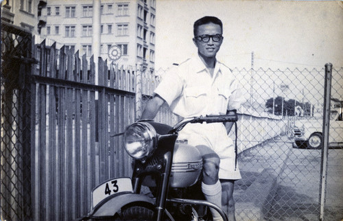 Image: Hon in his postal inspector uniform in 1957. He joined the Hong Kong Post Office in 1956. Courtesy of Choi Yan-chi.
