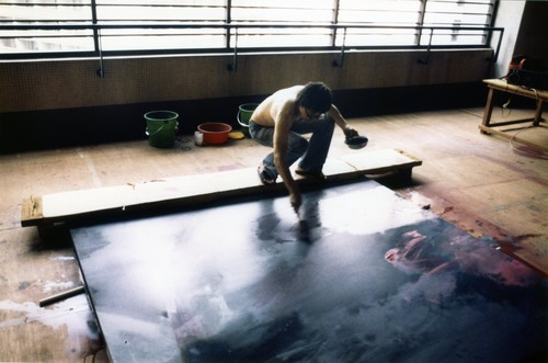Image: Hon working a series of four paintings, <i>The Making of the Spheres</i>, commissioned by Jardine House in the late 1990s.
