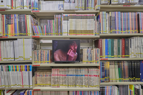 Image: JiangZhuyun, <I>Sound of Temperature</I>, 2005, video documentation of performance, 7'40'', installation view of <I>Learning What Can't Be Taught</I>, AAA Library, 2021. Photo: Kitmin Lee.