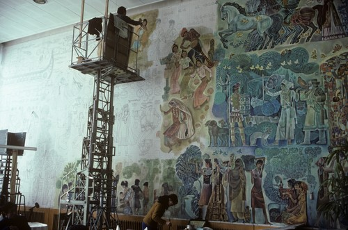 Image: Photograph of Liu Bingzhang (left) and Zhou Lin (right), working on a mural called <i>Creativity Reaping Happiness</i> at the Peking Hotel, Beijing, circa 1980–82. From AAA's Joan Lebold Cohen Archive.
